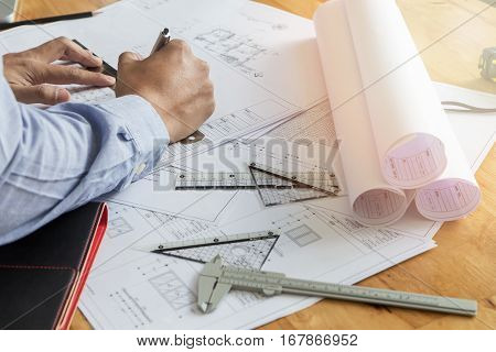 Architect drawing plan on blueprint architectural concept