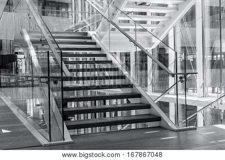 Indoors stairs in a modern architecture building. Black and white high contrast picture