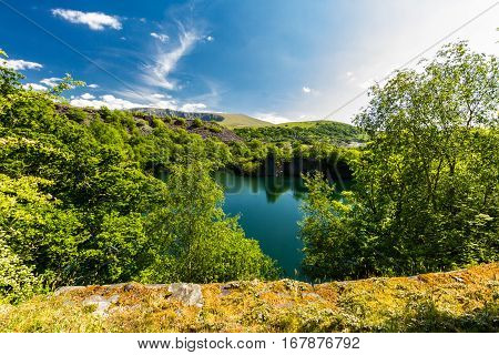 Looking across the disused Cornwall Slate Quarry Nantlle Gwynedd Wales United Kingdom. Flooded with water.