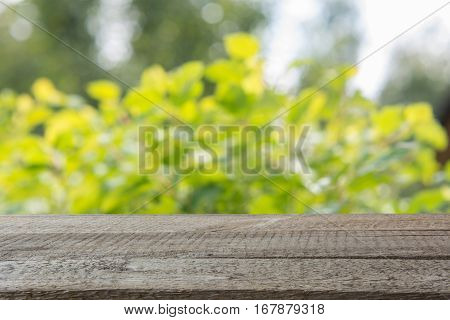 Natural bokeh abstract pattern background with tabletop and display for your product.