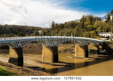Old road bridge over River Wye connecting Chepstow Wales and Tutshill England.