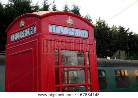 Alresford, Uk - Jan 28 2017: Vintage British Telephone Box And Railway Carriages At Alresford Statio