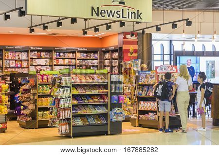 Melbourne, Australia - September 27, 2016: View of people buying books at a duty free bookshop at Melbourne airport.