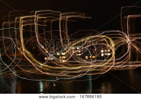 Lightpainting light trails and reflections at night - long exposure