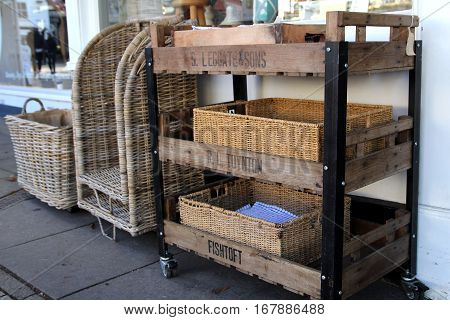 New Alresford, Uk - Jan 28 2017: Traditional Wooden And Wicker Trolley And Trays Outside A Shop In B