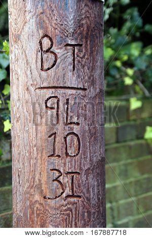 Alresford, Uk - Jan 28 2017: British Telecom Reference Number Carved Into A Traditional Wooden Teleg