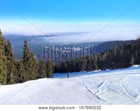 Aerial panorama of winter town houses, ski slopes in bulgarian alpine ski resort Borovets