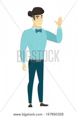 Young asian businessman waving his hand. Full length of businessman waving his hand. Businessman making greeting gesture - waving hand. Vector flat design illustration isolated on white background.