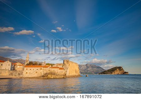 view of beauty sunset over Sveti Stefan small islet and resort in Montenegro. Balkans Adriatic sea Europe.