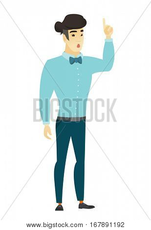 Asian  businessman with open mouth pointing finger up. Full length of young businessman with open mouth came up with business idea. Vector flat design illustration isolated on white background.