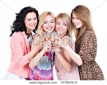 Group of young happy women have party and drinking wine - isolated on white.