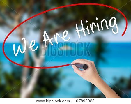Woman Hand Writing We Are Hiring  With Black Marker On Visual Screen