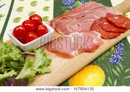 Cold Tapas Cold Tapas - Spanish style taps with a meat selection of serrano lomo salami salad and tomatoes