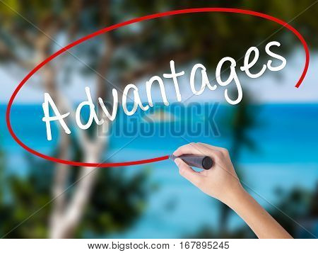 Woman Hand Writing Advantages With Black Marker On Visual Screen