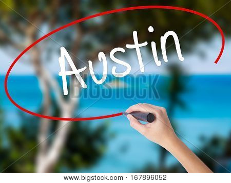 Woman Hand Writing Austin  With Black Marker On Visual Screen