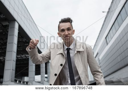 Angry Businessman Pointing His Finger At The Viewer.