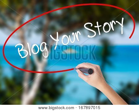 Woman Hand Writing Blog Your Story  With Black Marker On Visual Screen