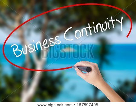 Woman Hand Writing Business Continuity With Black Marker On Visual Screen