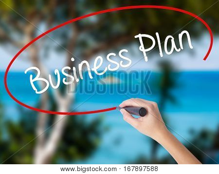 Woman Hand Writing  Business Plan With Black Marker On Visual Screen