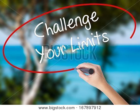 Woman Hand Writing Challenge Your Limits With Black Marker On Visual Screen