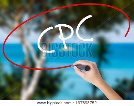 Woman Hand Writing Cpc (cost Per Click)  With Black Marker On Visual Screen