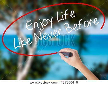 Woman Hand Writing Enjoy Life Like Never Before With Black Marker On Visual Screen