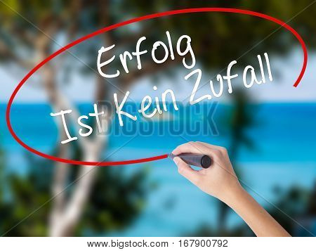 Woman Hand Writing Erfolg Ist Kein Zaufall (success Is No Accident In German) With Black Marker On V
