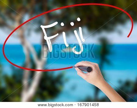 Woman Hand Writing Fiji  With Black Marker On Visual Screen.