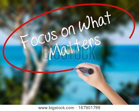 Woman Hand Writing Focus On What Matters With Black Marker On Visual Screen