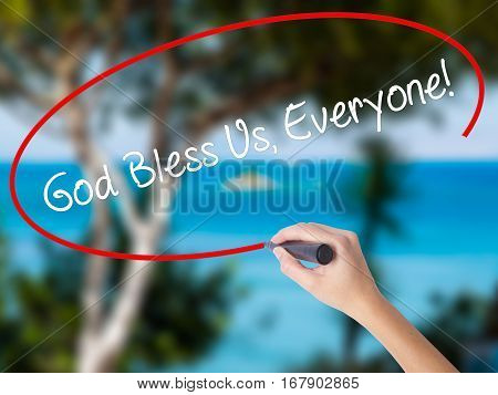 Woman Hand Writing God Bless Us, Everyone! With Black Marker On Visual Screen