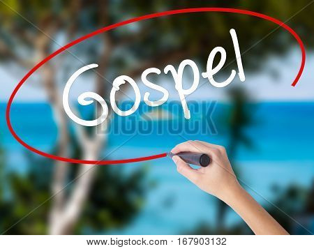 Woman Hand Writing Gospel  With Black Marker On Visual Screen