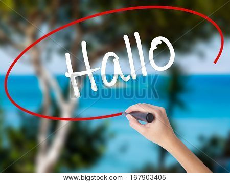 Woman Hand Writing Hallo  (hello In German) With Black Marker On Visual Screen