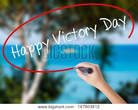 Woman Hand Writing Happy Victory Day With Black Marker On Visual Screen.