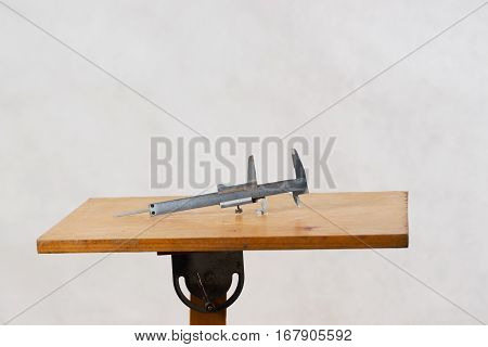 Different construction tools on a wooden background - screwdriver caliper. Top view.