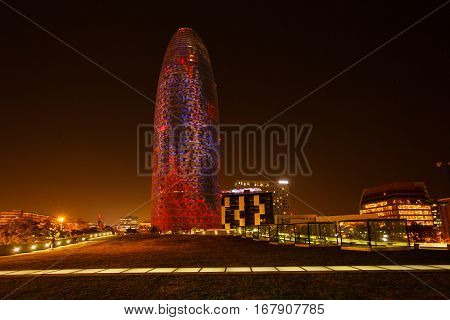 Barcelona Spain - January 04 2017: Colorful luminous facade of the Agbar tower in the night