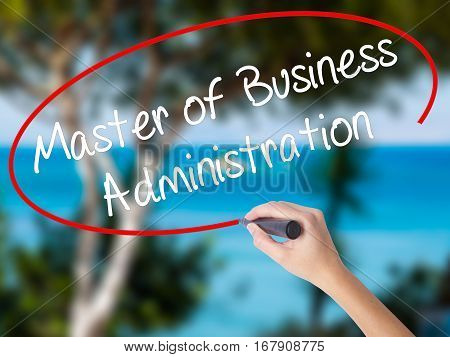 Woman Hand Writing Master Of Business Administration With Black Marker On Visual Screen