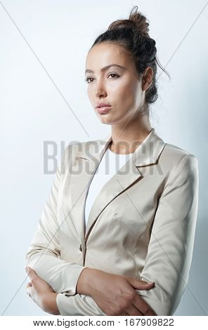Serious businesswoman standing arms crossed.
