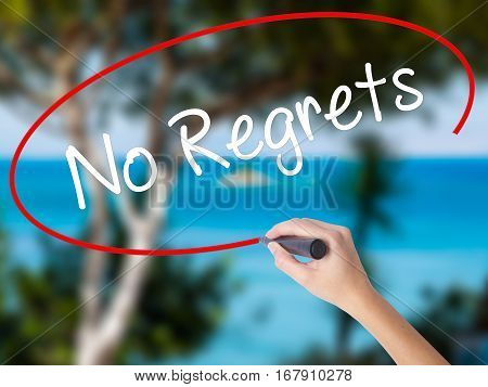 Woman Hand Writing No Regrets With Black Marker On Visual Screen