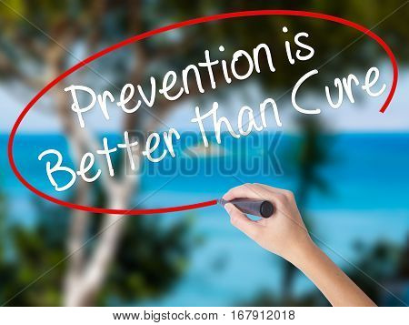 Woman Hand Writing Prevention Is Better Than Cure With Black Marker On Visual Screen