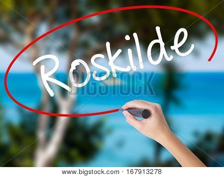 Woman Hand Writing Roskilde With Black Marker On Visual Screen