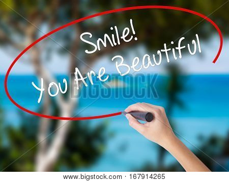 Woman Hand Writing Smile! You Are Beautiful With Black Marker On Visual Screen