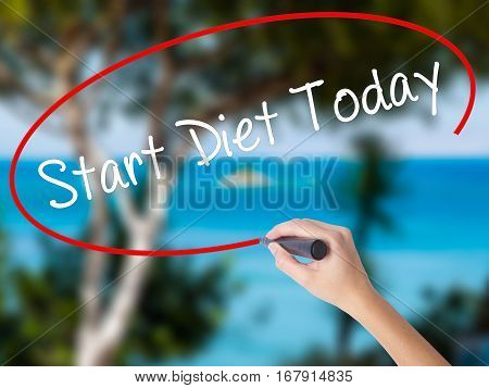 Woman Hand Writing Start Diet Today  With Black Marker On Visual Screen