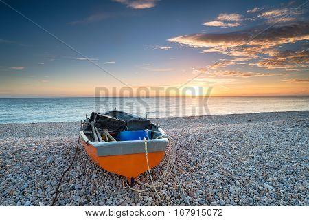 Orange Boat At Sunset