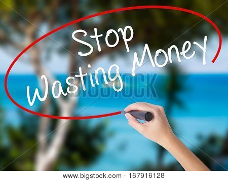 Woman Hand Writing Stop Wasting Money With Black Marker On Visual Screen