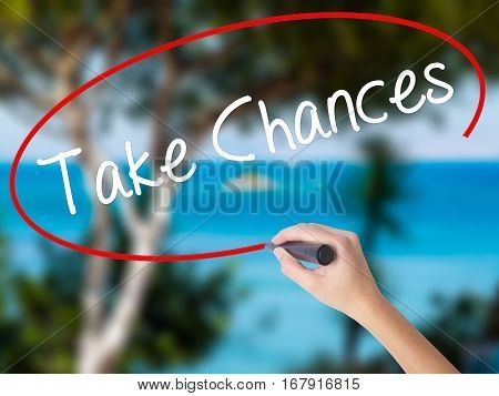 Woman Hand Writing Take Chances With Black Marker On Visual Screen.