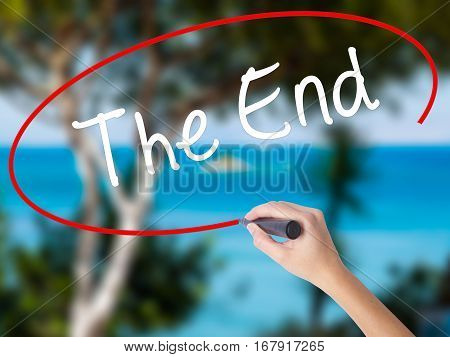 Woman Hand Writing The End With Black Marker On Visual Screen