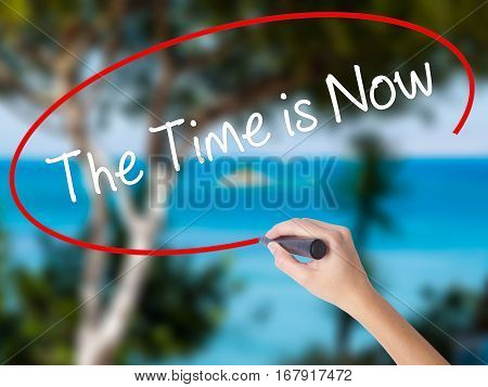 Woman Hand Writing The Time Is Now With Black Marker On Visual Screen