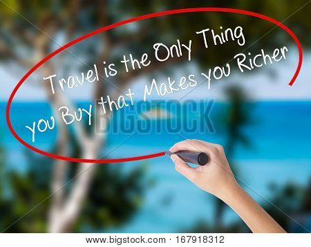 Woman Hand Writing Travel Is The Only Thing You Buy That Makes You Richer With Black Marker On Visua