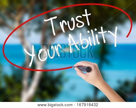 Woman Hand Writing Trust Your Ability  With Black Marker On Visual Screen