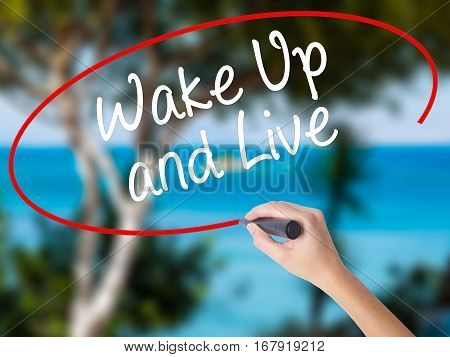 Woman Hand Writing Wake Up And Live With Black Marker On Visual Screen.
